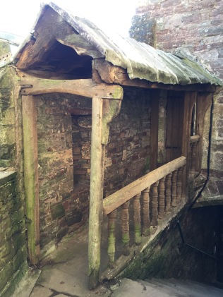 In 1327, the door way was not covered by a wooden roof